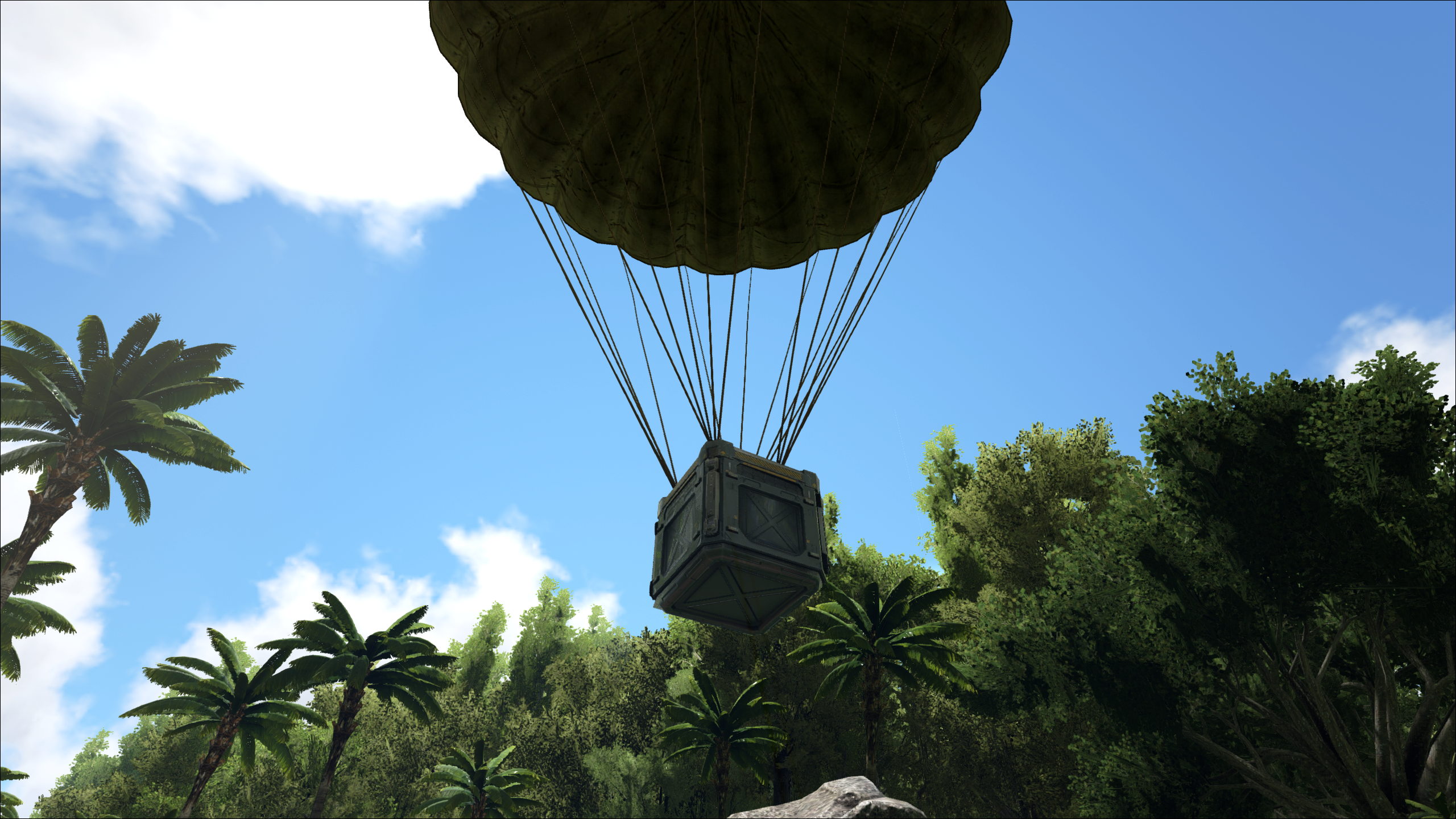 A supply drop parachutes in