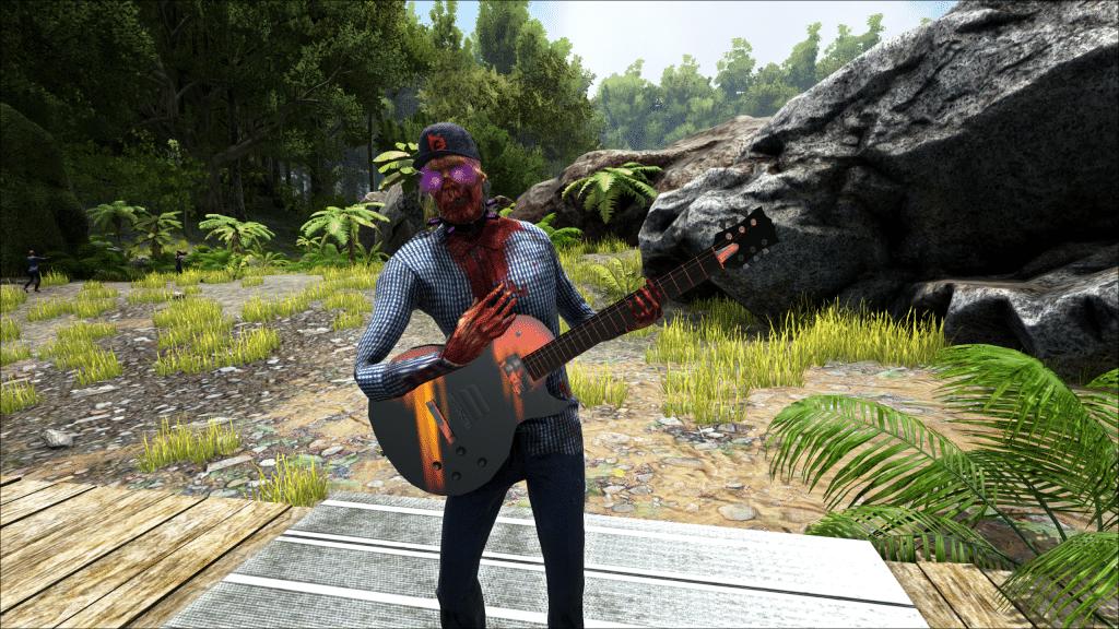 A captive zombie plays guitar